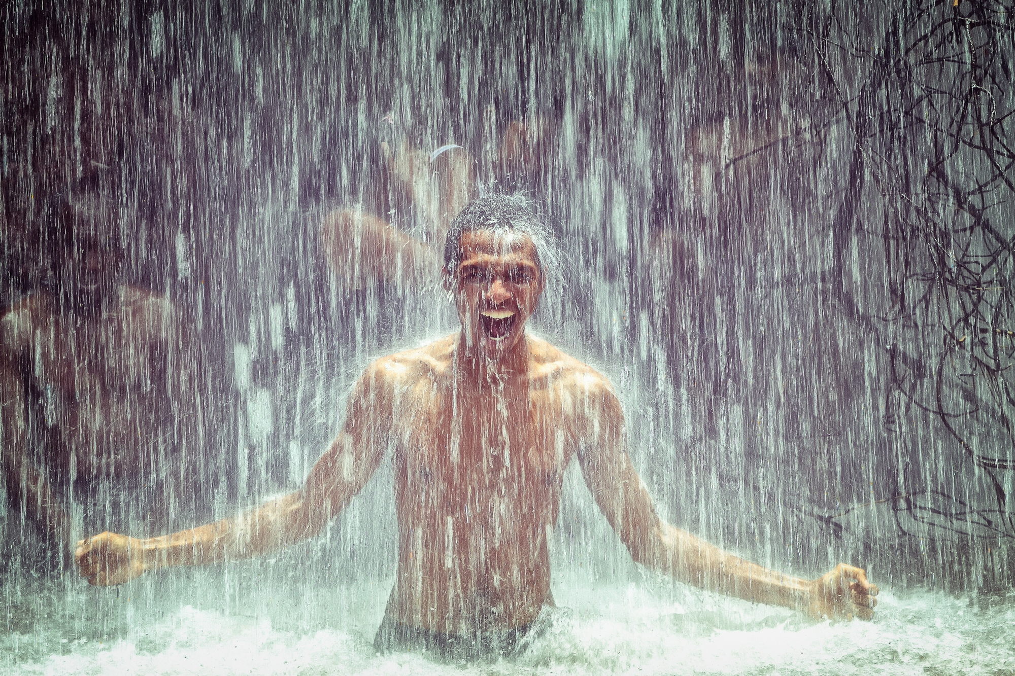 man-under-waterfall-2150164